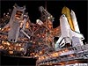 A picture taken at night of the space shuttle on the launch pad