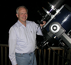 Ralph Pass standing next to his telescope