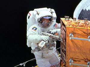 Astronaut working on the Hubble Space Telescope