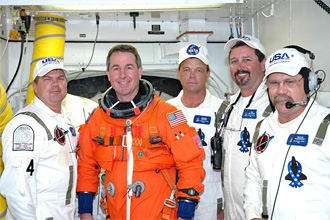 STS-114 Mission Specialist Steve Robinson with members of the Closeout Crew