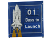 A road-side sign at NASA's Kennedy Space Center marks one day until the launch of Discovery.