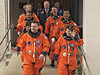 STS-114 crew exits the Operations and Checkout Building
