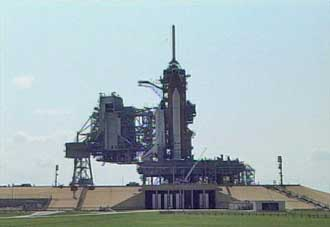 Space Shuttle Discovery rests in full view on the launch pad.
