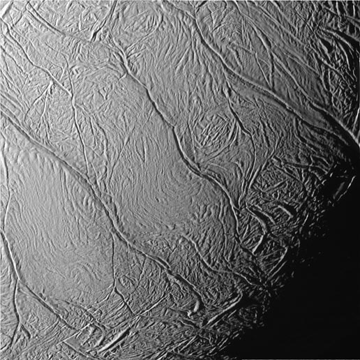 This close-up view of Saturn's moon Enceladus looks toward the moon's terminator.