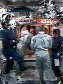 The ISS crew greets STS-114
