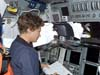 Commander Eileen Collins works on Discovery's flight deck