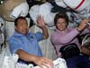 Mission Specialist Soichi Noguchi and Commander Eileen Collins in Space Shuttle Discovery's middeck