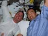 Astronauts Steve Robinson and Soichi Noguchi take a break