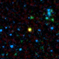 False-color image from NASA's Spitzer Space Telescope showing a distant galaxy that houses a quasar