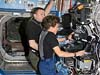 STS-114 Mission Specialist Wendy Lawrence and Pilot Jim Kelly work at the Canadarm2 workstation