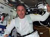 STS-114 Mission Specialist Steve Robinson prepares for a spacewalk with fellow Astronaut Soichi Noguchi