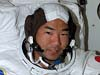STS-114 Mission Specialist Soichi Noguchi prepares for a spacewalk with fellow Astronaut Steve Robinson