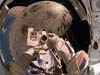 STS-114 Mission Specialist Steve Robinson used the pictured digital camera to expose a photo of his helmet visor