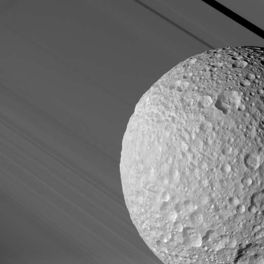 Mimas seen against backdrop of Saturn's rings