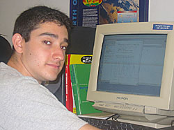 Adam Greenbaum sitting at a computer