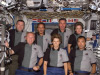 The STS-114 crewmembers pose for an in-flight portrait