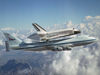 Space Shuttle Discovery stops atop NASA's modified Boeing 747 Shuttle Carrier Aircraft.
