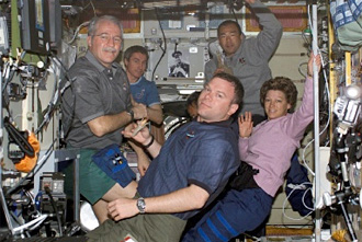 STS-114 and Expedition 11 crew members