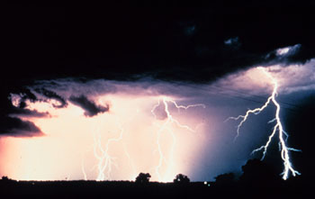 Image of a thunderstorm with cloud to ground lightning at night.