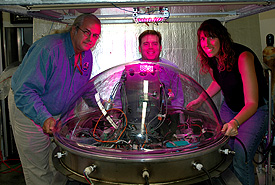 Phil Phowler, Jim Clawson and Erin Wilkerson gather around a Mars Jar.
