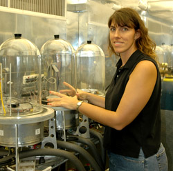 Erin Wilkerson adjusts one of her plant test chambers.