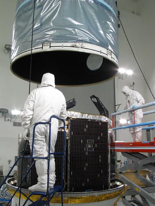 workers examine CloudSat in hangar at Vandenberg Air Force