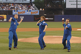 From left, Astronauts Soichi Noguchi, Eileen Collins and Charlie Camarda throw out the first pitch at a New York Mets game. Photo Credit: NASA/Bill Ingalls