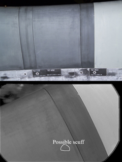 screeners comparing the on-orbit photo (below) of this wing panel to the pre-flight photo (above)