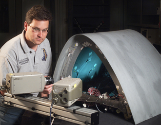 NASA Glenn engineer Duane Revilock sets up a high-speed digital camera
