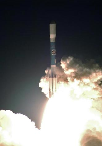 Liftoff of the Delta II rocket carrying the twin STEREO spacecraft.