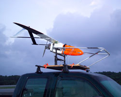 Image of the unmanned aircraft, the Aerosonde, on top of the truck from which it is launched.