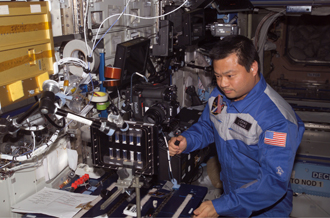Photo: Astronaut Leroy Chiao examines BCAT-3 samples on space station
