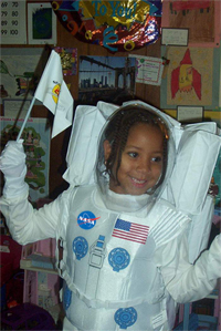 A young girl is dressed as an astronaut