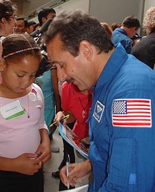 Astronaut Charles Camarda with a young friend
