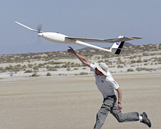 Aerospace engineer Michael Allen readies the Autonomous Soaring project's sailplane.