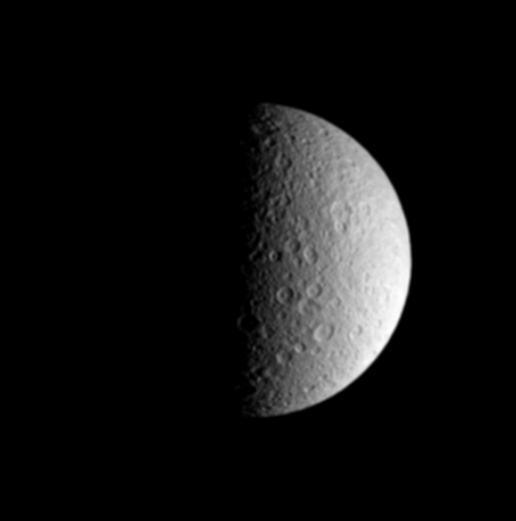 21797fda909 This half-lit view beautifully captures the ponderously old and cratered  surface of Saturn s icy moon Rhea. Rhea is 1