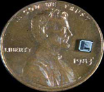 A microchip seated on a penny