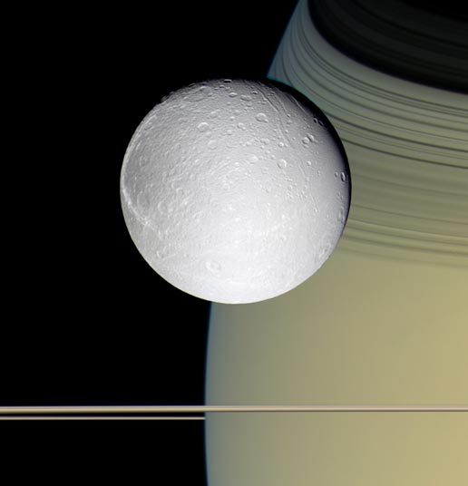 Dione with backdrop of Saturn and edge-on view of rings