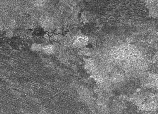 radar image of Titan showing what's called cat scratches, which may be dunes of water ice or hydrocarbon particles