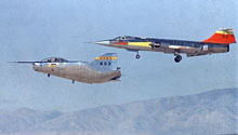 M2-F2 lifting body landing with F-104 chase plane.