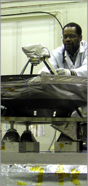 Image of an APL technician secures the electrical harness routed to the high-gain antenna on the STEREO