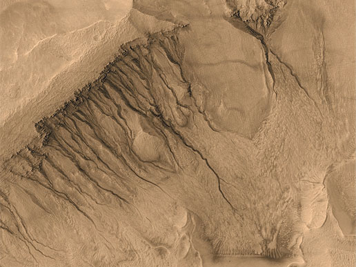 Unusual Gullies and Channels on Mars.Photo Credit: Malin Space Science Systems, MGS, JPL, NASA