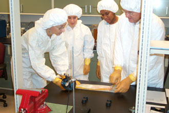 Photo: Researchers/students in clean room