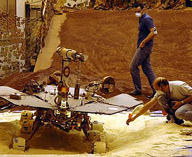 Engineers test escape techniques with a spare rover.