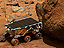 The Sojourner rover examines a martian boulder.