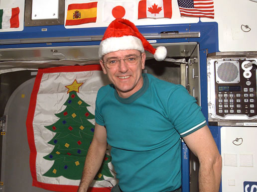 Astronaut Bill McArthur with Christmas decorations
