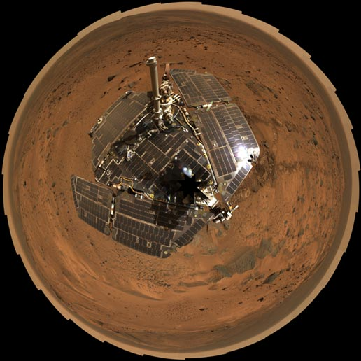 combined self-portrait of the spacecraft deck and a panoramic mosaic of the Martian surface as viewed by Spirit
