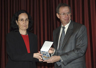NASA Administrator Michael Griffin presents the agency's Exceptional Scientific Achievement Medal to Neta Bahcall, widoe of acclaimed American astronomer and astrophysicist John Bahcall. Photo Credit: NASA/Bill Ingalls
