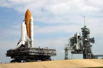 Discovery rides aboard the crawler to the launch pad.