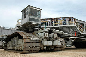 Media tour the crawler transporter during the 40th anniversary celebration